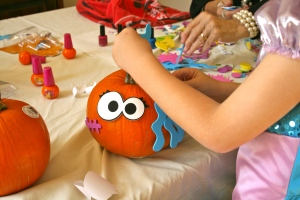 C.J. decorating his pumpkin.  He gave her long blue wavy hair all the way around.