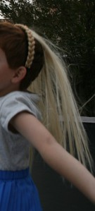 """His favorite gift of all...Uncle Uncle got a headband with a blonde braid attached, purchased extensions of real hair and hand sewed them onto the braided headband.  C.J. can have long, blonde """"girl hair"""" whenever he wants."""