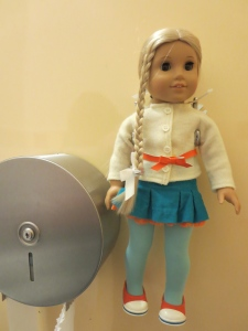 There's a holder for your doll in the bathroom stall so that she can watch you pee.  Not weird at all.