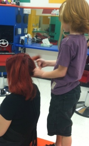 C.J. doing Miss. Crystal's hair.